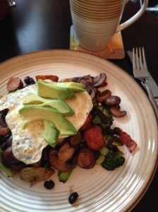 Epic brunch- roasted potatoes and broccoli with mushrooms and black beans topped with an egg and avocado